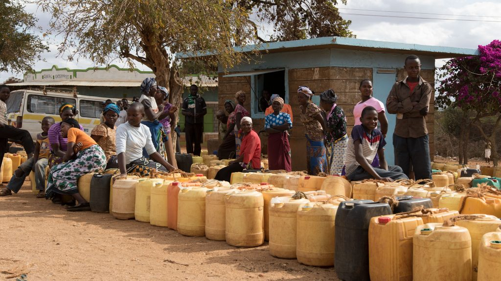 Queue at a so-called water kiosk where you can buy clean water at a low cost.