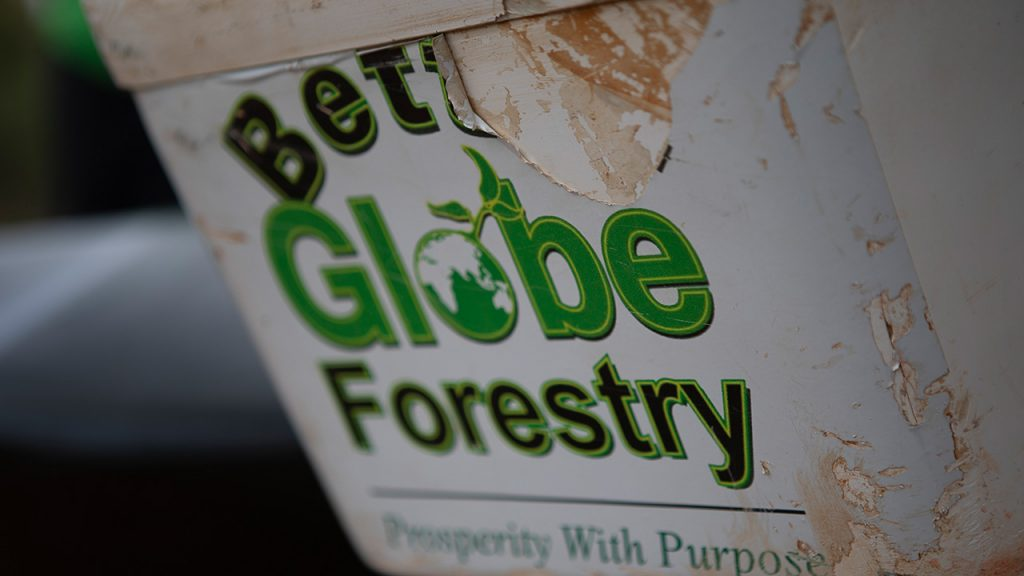 A box with Better Globe Forestry stickers on one of the forest rangers motorbikes. Kenya, July 2018
